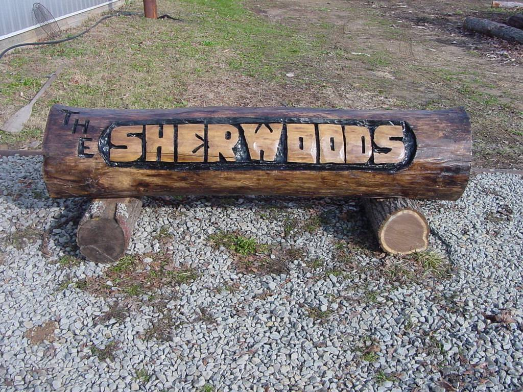 Bear tracks chainsaw carving. some of the signs that we do.